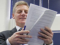 COST CUTTER: Bill English with a copy of the 2012 Budget.