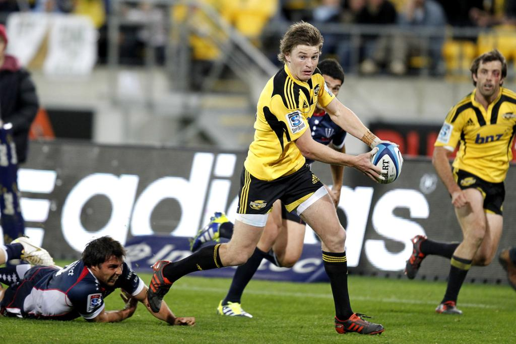 Beauden Barrett breaks away during the Hurricanes 66-24 win over the Rebels.