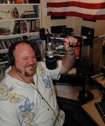 FOREIGN FREQUENCY: Ex-pat Texan Patrick Brennan broadcasts his radio station AndHow.FM to tens of thousands of international listeners from his home studio in Papakowhai.