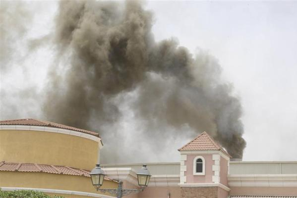 Smoke billows from the Villaggio Mall during a fire, in Doha's west end.