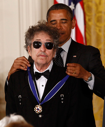 HONOURED: US President Barack Obama awards a 2012 Presidential Medal of Freedom to musician Bob Dylan.