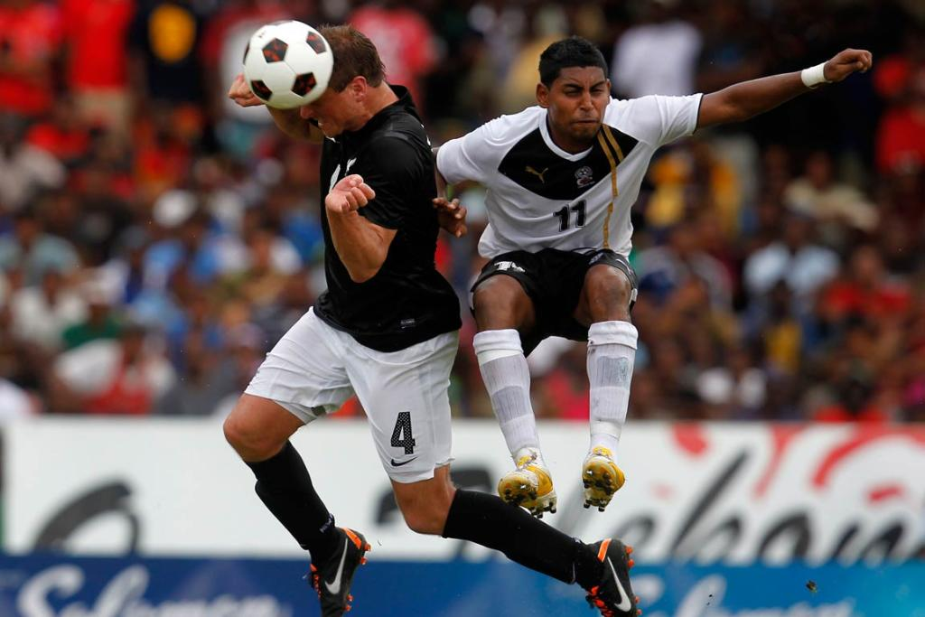 All Whites defender Ben Sigmund heads the ball in front of Fiji's Roy Krishna.