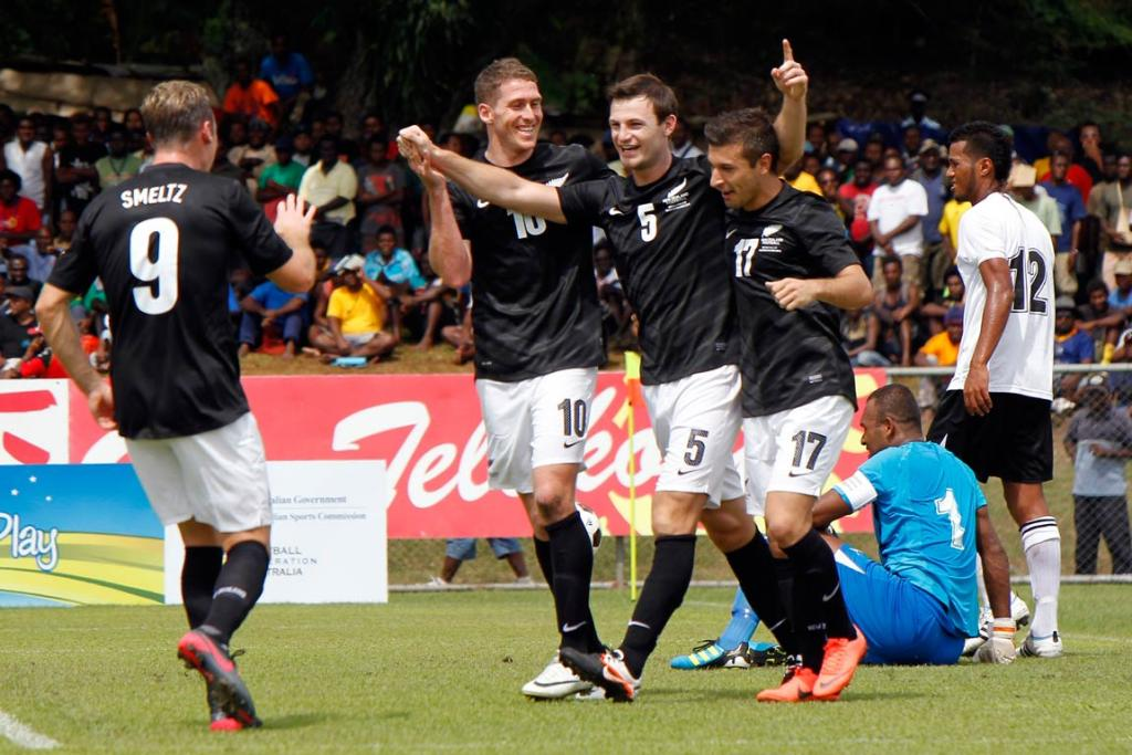 Tommy Smith (centre) celebrates his first international goal with Shane Smeltz, Chris Killen and Kosta Barbarouses.