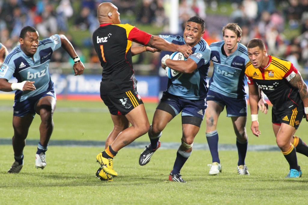 Blues player Francis Saili is tackled by Chiefs player Sona Taumalolo.