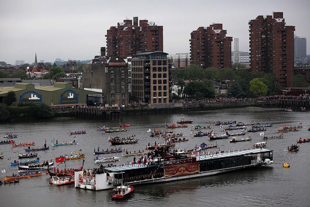 Boats make their way down the River Thames in London for the river pageant. For only the second time in its history Britain celebrates the Diamond Jubilee of a monarch.