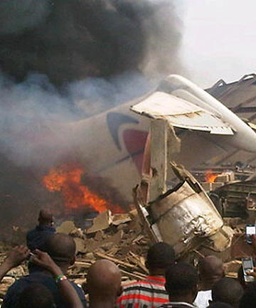 DEVASTATING: The wreckage of a plane burns in Nigeria's commercial capital Lagos.