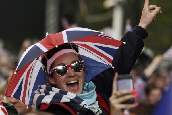 A spectator enjoys the Diamond Jubilee concert at Buckingham Palace in London.