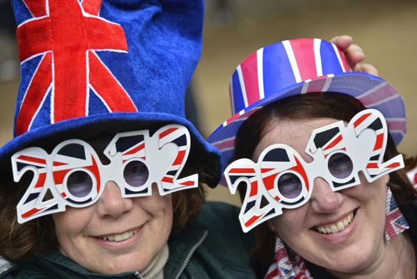Friends Jenny Miles (left) and Jane Pratt pose on The Mall as they wait on The Mall for the start of the Diamond Jubilee concert for Britain's Queen Elizabeth in London.