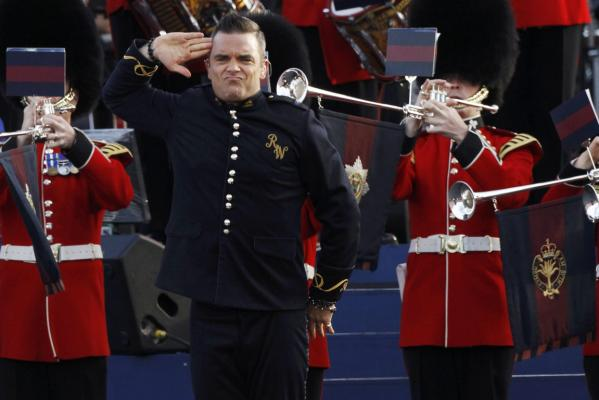 Singer Robbie Williams performs during the Diamond Jubilee concert in front of Buckingham Palace in London.