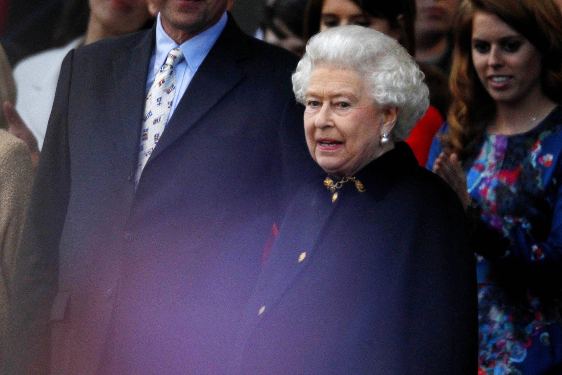 Britain's Queen Elizabeth watches during her Diamond Jubilee concert in front of Buckingham Palace in London.