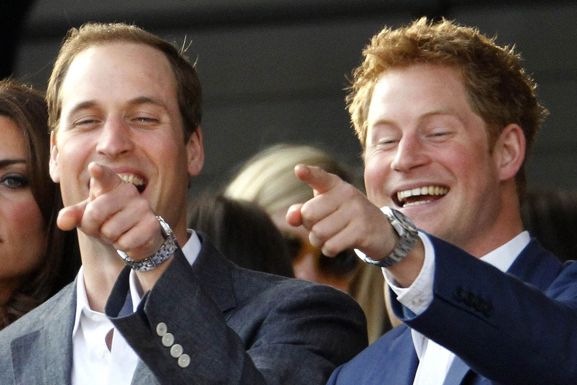 Princes William and Harry laugh as they sing along during the Diamond Jubilee concert at Buckingham Palace in London.