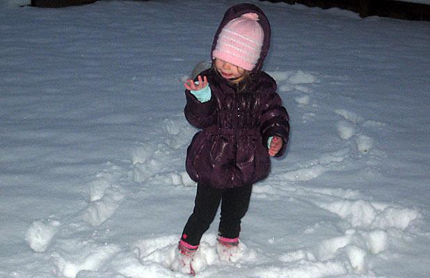 NEVER TOO EARLY: Jazmine was out playing in the Twizel snow before daylight.