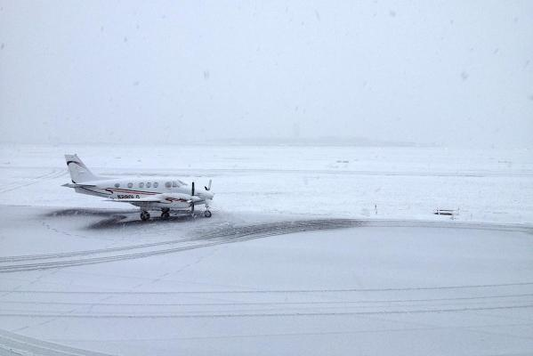 Snow falls at Christchurch Airport.