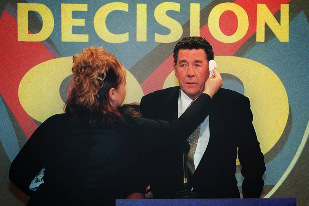 Paul Holmes gets a wipe down before a televised Leader's Debate at Avalon studios.