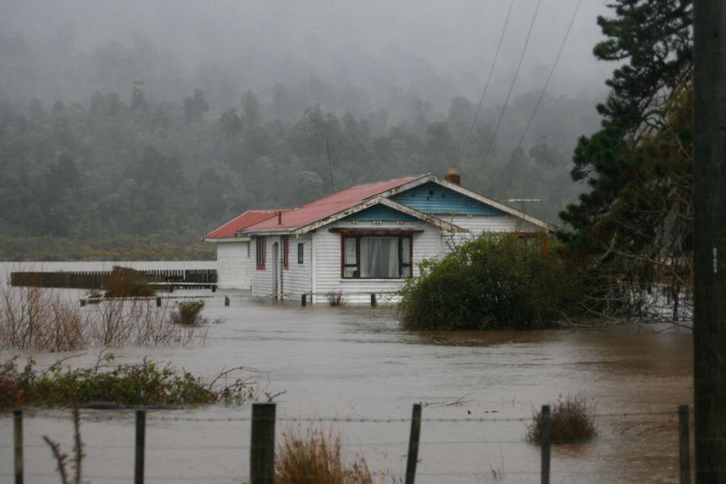 A house surrounded by floodwaters north of Greymouth.