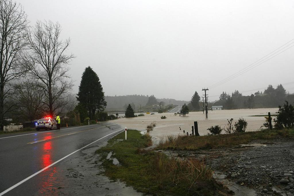 Police closed SH6 north of Greymouth to most traffic after McLeans Creek overflowed.