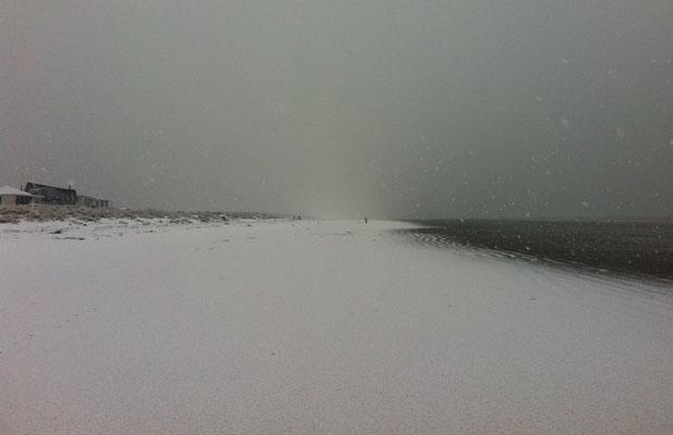 WATER'S EDGE: Snow reaches the sea at Southshore beach.