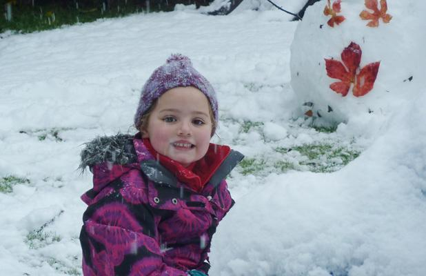 GETTING CREATIVE: Maya Stiven makes snowmen in her Beckenham backyard today.