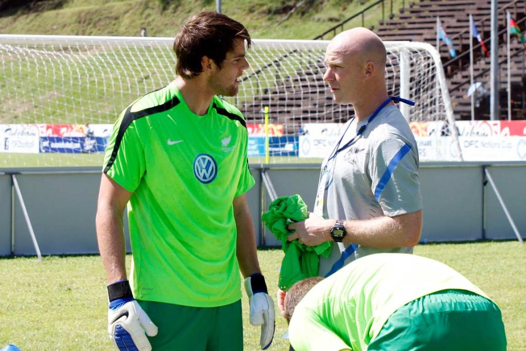 All Whites goalkeeper Jake Gleeson chats with assistant coach Neil Emblen.