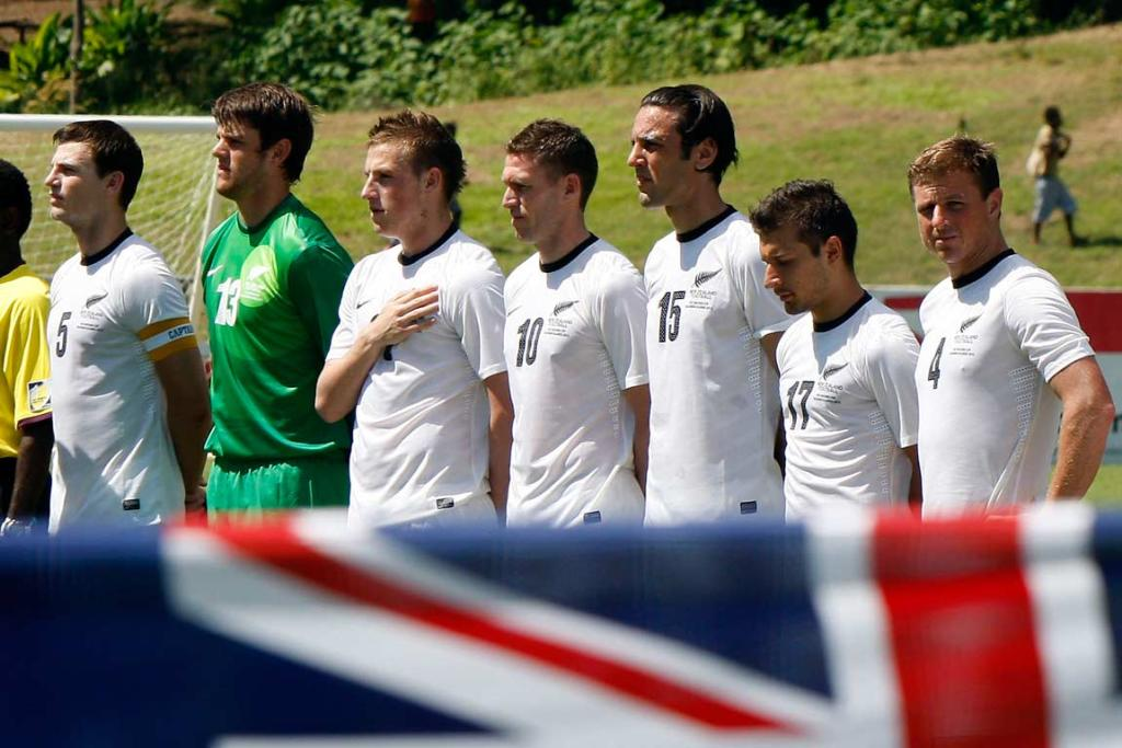 The All Whites line up for the national anthems in Honiara.