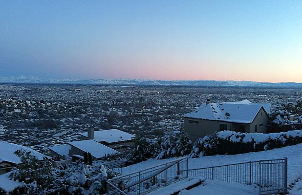 DAWN: Skies clear and cold over a snow-covered Christchurch.