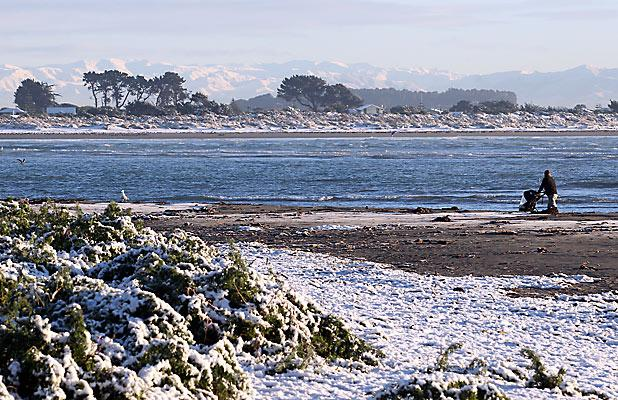 A RARE SIGHT: Snow on Sumner beach in June.