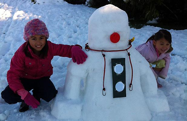 ROBOT-MAN: Kyra Elliott, 9, and Alexis Elliott, 5, in Mairehau with their robotic snowman.