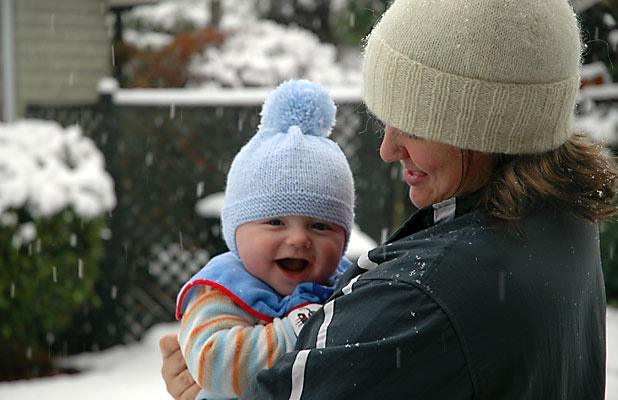 FIRST SNOW: James Leuzzi, 4 months, enjoying his first taste of snow in Hillmorton, Christchurch.