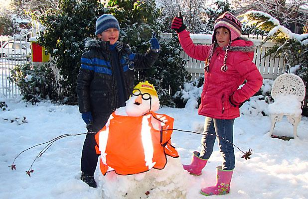 QUAKE-MAN: Izak and Monica Koster with their EQC inspector snowman.