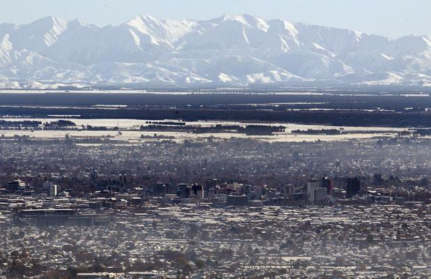 The city and hills bask in sunshine the day after the big snowfall.