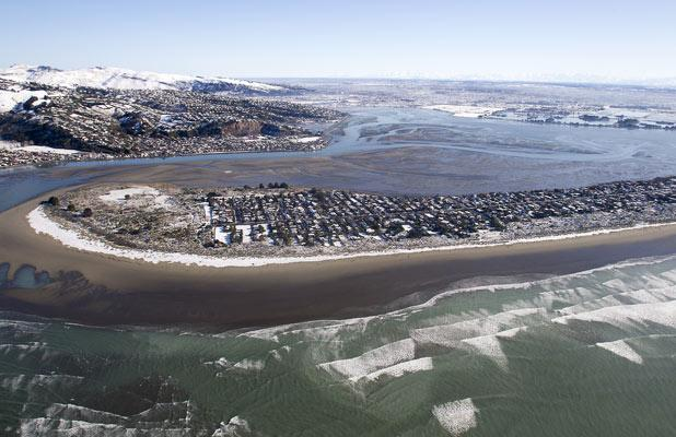 Snow rings the high tide mark at South Shore.