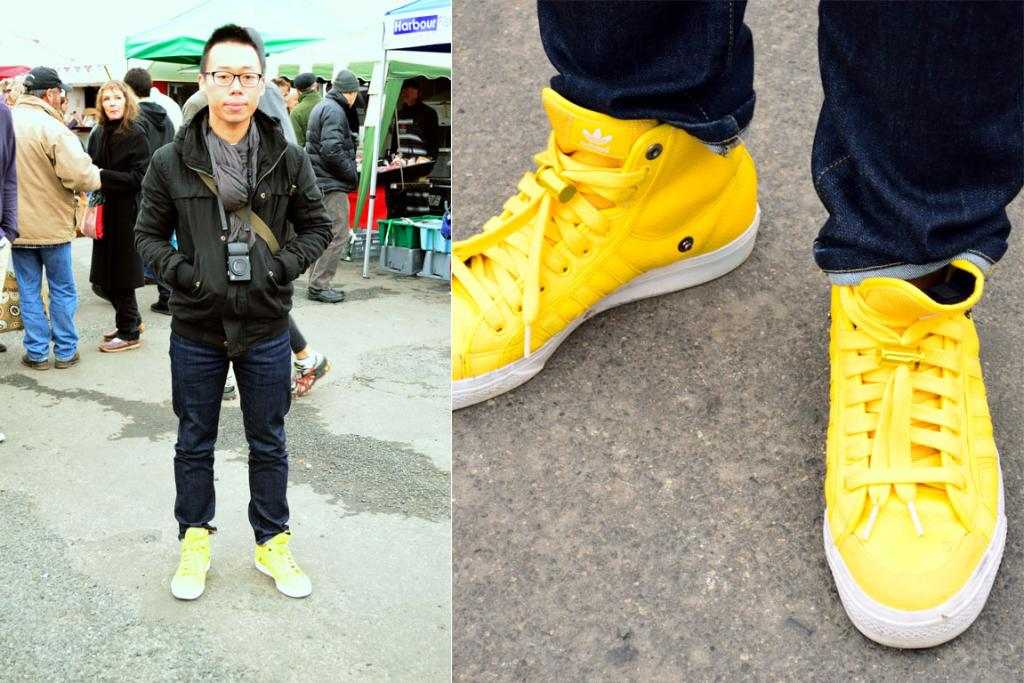 Tom, pictured at the Otago Farmers Market in bright yellow Adidas sneakers.