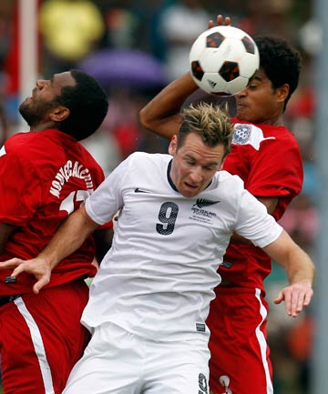 GO NO FURTHER: All Whites forward Shane Smeltz goes up to head the ball in front of two New Caledonia players during the semifinal loss at the Oceania Nations Cup.