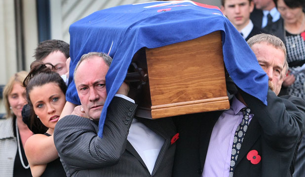 FOND FAREWELL: Sir Brian Talboys' sons, Drew and Guy, help carry his coffin from the Winton Salvation Army Centre after the former deputy prime minister's funeral yesterday.