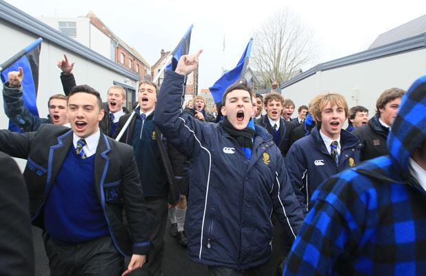 """HIGH SPIRITS: Christchurch Boys High students announce their arrival on """"enemy"""" territory for the annual rugby clash with Christ's College."""