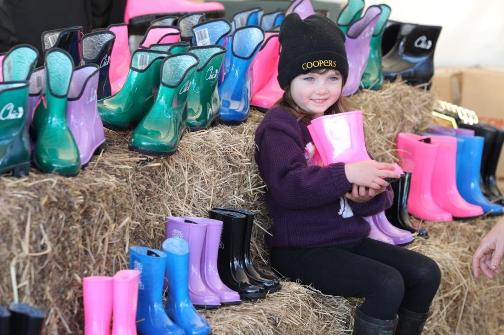 Maggie Murdock, 5,  from Patetonga checks out colorfully range of commando gumboots.