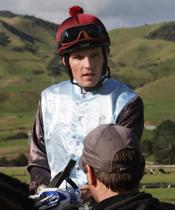 RUNNING HOT: Leading Cambridge jockey Jason Waddell talks to connections after a trial ride at Paeroa yesterday.