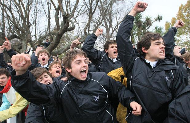 CHEERS: Christ's College boys' support for their team never flagged despite the one-sided scoreboard.