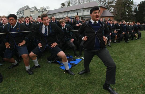 IN THE LEAD: Kao Pirini leads his CBHS schoolmates in a half-time haka.