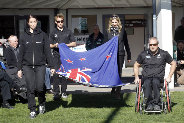 Olympians come out to raise the New Zealand flag at the opening ceremony. L to R: Sarah Walker, Kurt James, Katy McVean, Danny McBride.