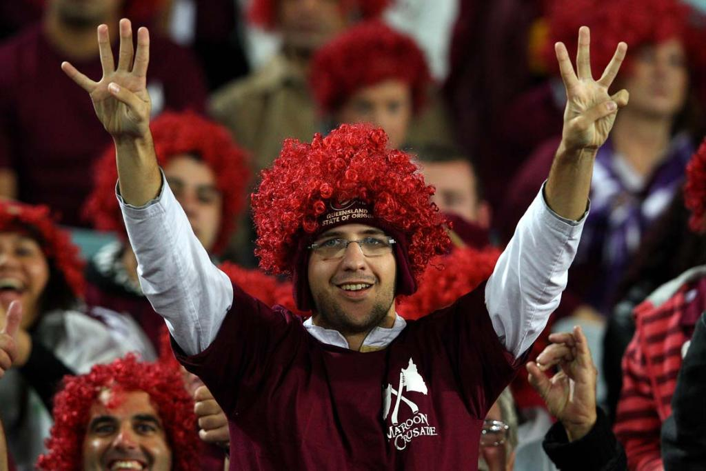 A Queensland fan holds up seven fingers, as the Maroons hope to make it seven straight series wins.