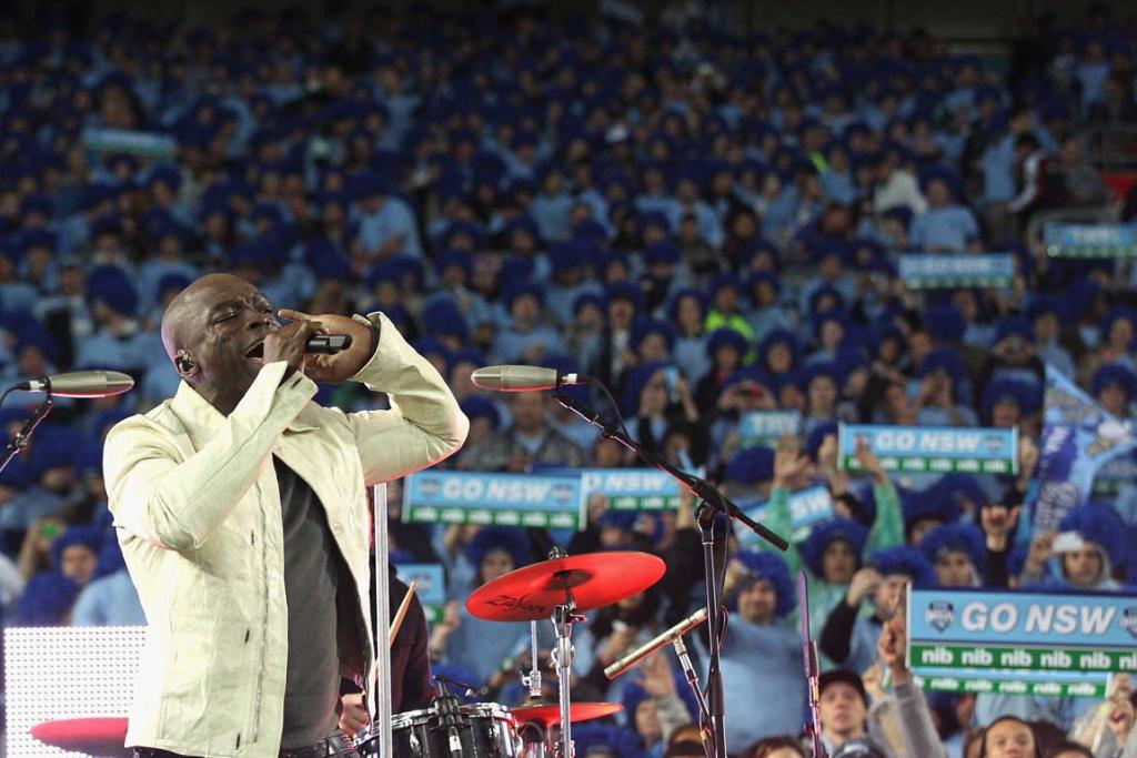 Seal sings during pre-match entertainment, with New South Wales fans in the background.