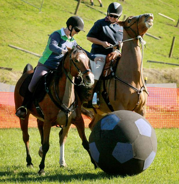 Helen Hansen and Katie Stockholme taking part in 'Hoof Ball' at Fieldays.