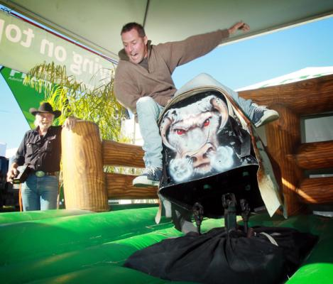 Paul Hammond from Lake Rotoehu tries his balancing skills on a mechanical bullride.