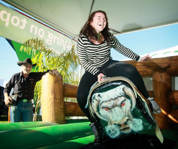 Maddison Gerosh from Raglan tries her balancing skills on a mechanical bullride.