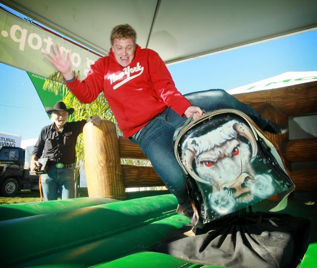FIELDAYS ROCKS OFF: A day one highlight at the agricultural show was the mechanical bull riding; Aucklander Mitchell Goff shows here how it is done.