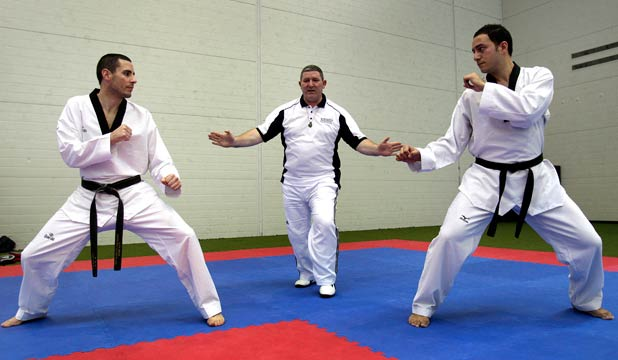 READY, SET, FIGHT!: Stan Wagner (centre) is the only New Zealand taekwondo referee officiating at the London Olympics next month. Here he referees New Zealand representatives Alan Brian (left) and Caleb Matafeo.