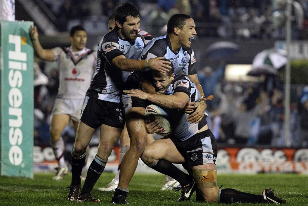 Jeff Robson is congratulated by team-mates after scoring the winning try for Cronulla against the Warriors.