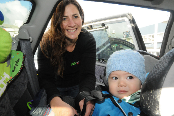 "SECURED: Nine-month-old Olly Young has his car seat checked by Jane Knackstedt. ""I had it mostly right but I was glad I came down to make sure,'' said mum Anna."