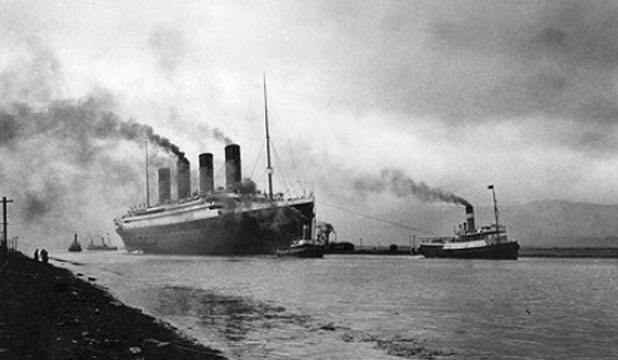 ORIGINAL: The SS 'Titanic', leaving Belfast to start her trials, pulled by tugs, shortly before her disastrous maiden voyage of April 1912.